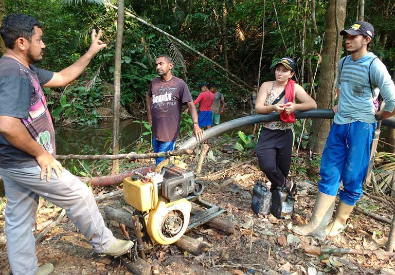 Ageu Pereira explaining to illegal gold miners that they need to move off his community's land