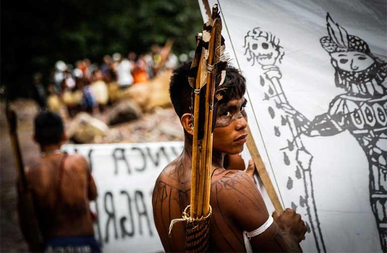 A Munduruku warrior prepares to occupy the São Manoel dam during a protest.