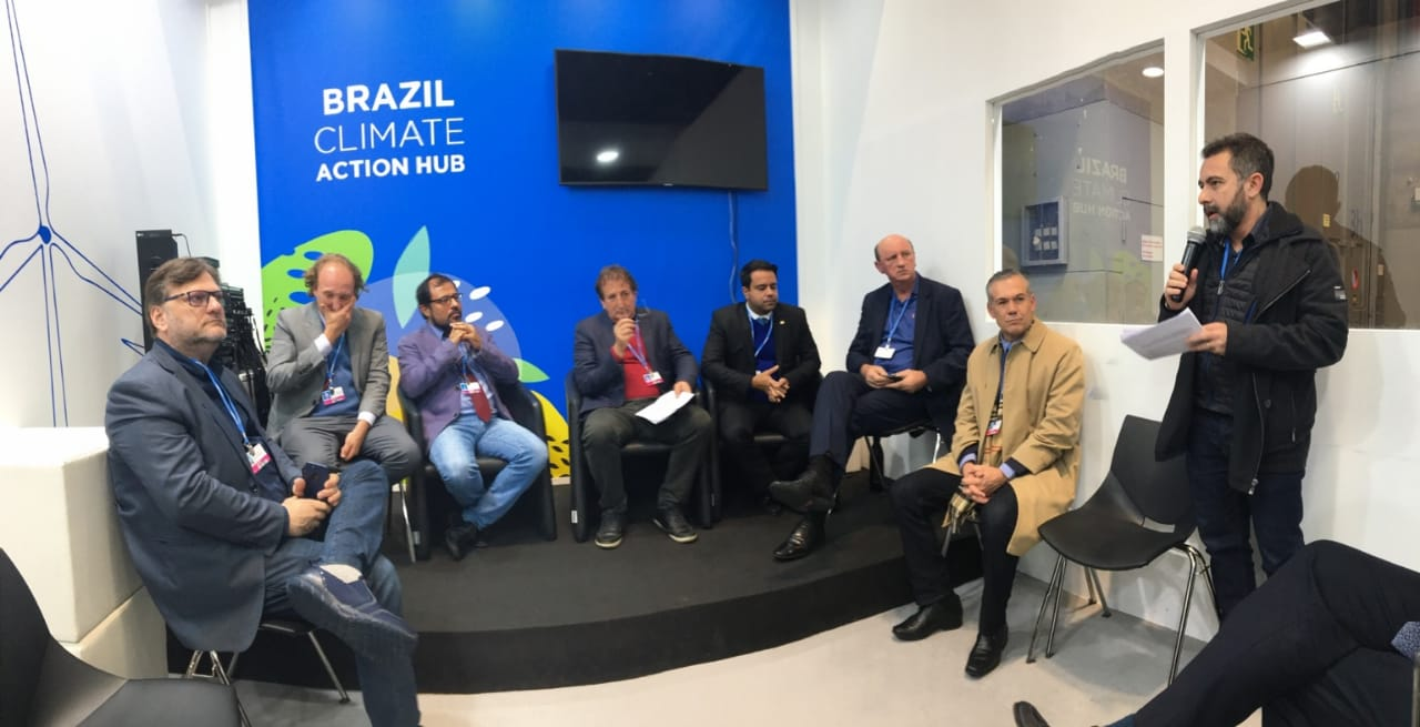 Márcio Astini of Greenpeace Brazil presenting joint CSO declaration to members of the Brazilian Congress at COP 25 in Madrid